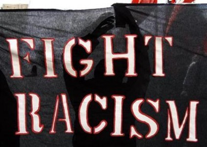 A protester holds a banner during a demonstration against racism in Geneva